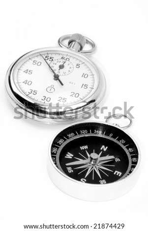 white watch and black compass - stock photo
