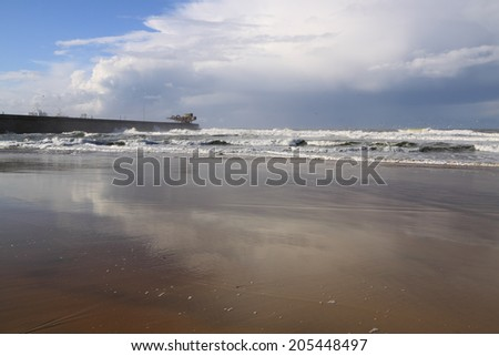 White waves against cloudy sky. North of Portugal. - stock photo