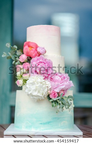 White wedding cake with flowers  - stock photo