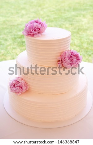 White Wedding Cake with Peonies - stock photo