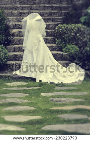 White wedding gown shot in a garden  - stock photo