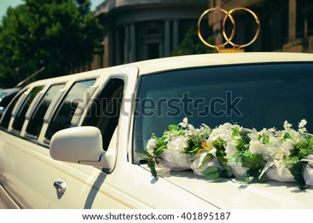 White wedding limousine decorated with flowers - stock photo