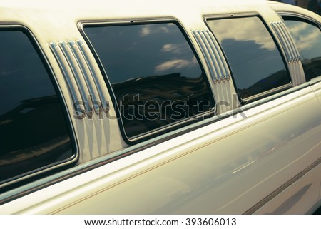 White wedding limousine long side view with windows - stock photo