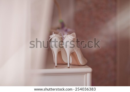 White wedding shoes for women. - stock photo