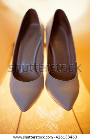 white wedding shoes on the lamp - stock photo