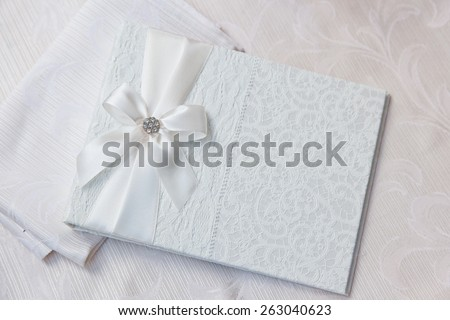 white wedding wish book decorated with bow and lace - stock photo
