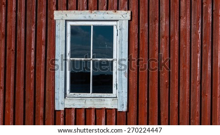 white window in a red wooden wall - stock photo