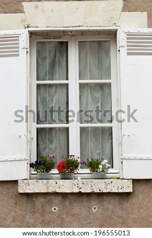 White window with shutters and flower pot - stock photo