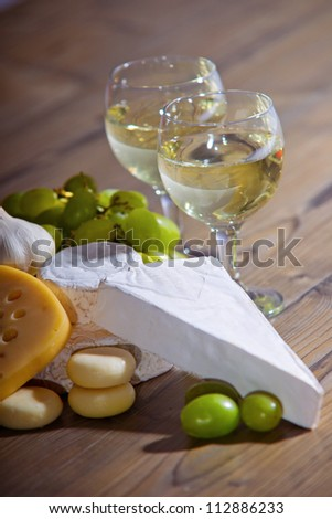 White wine and cheese composition - stock photo