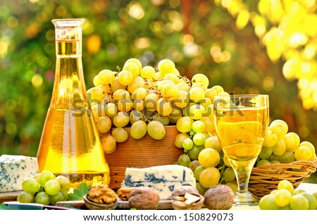 White wine and grape on table - Autumn harvest - stock photo
