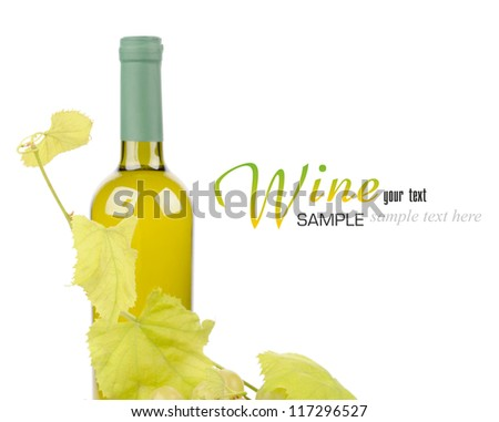 White wine bottle and grapes leaf isolated on white background - stock photo