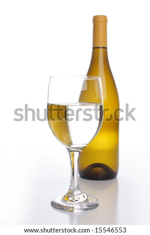 White wine bottle with a crystal glass - stock photo