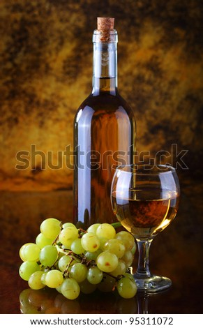 White wine composition with grape - stock photo