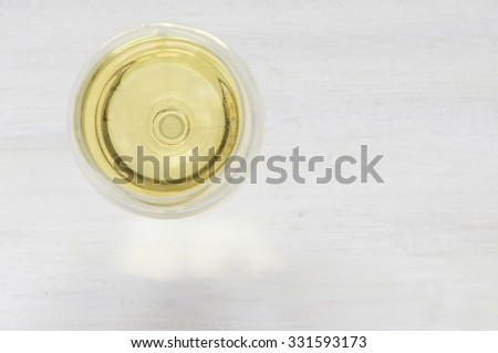White wine glass on a white background top view - stock photo