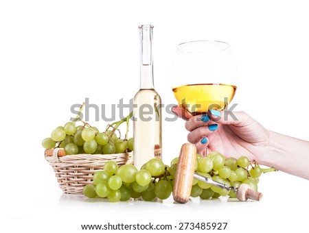 White wine in bottle and glass and a bunch of white grapes isolated on white - stock photo