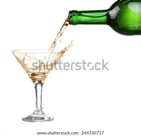 White wine pouring from the bottle intro the glass on white background - stock photo