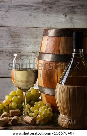 White wine still life with fresh grapevine - stock photo
