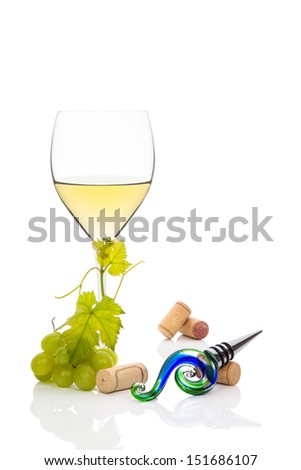 White wine with green grapes, wine corks and vine leaves isolated on white. Luxurious culinary wine drinking background. - stock photo