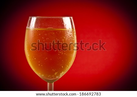 white wine with red background - stock photo