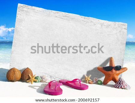 White Wooden Board with other Objects by the Beach - stock photo