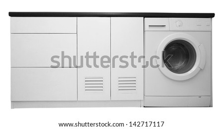 White wooden cabinet and washing machine inside - stock photo