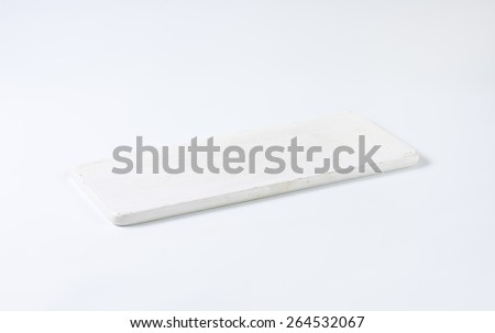 White wooden cutting board - stock photo