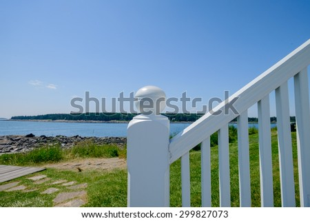 White wooden railing of the steps leading up to the light keepers lighthouse leading up to the light house keepers lighthouse - stock photo