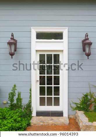 White wooden vintage door to the  house - stock photo