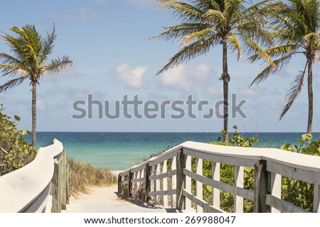 White wooden walkway leading to a beautiful tropical beach in Florida - stock photo