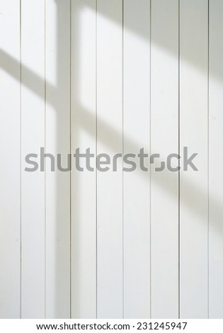 white wooden wall with sun light - stock photo
