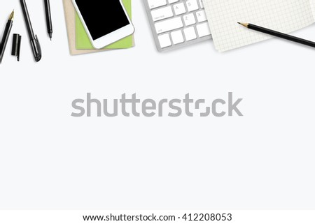White working desk with a lot of things on it. Top view with copy space. - stock photo