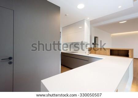 White worktop of contemporary kitchen interior - stock photo
