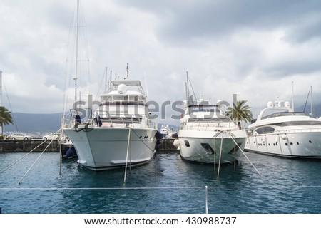 "White yacht at the dock. Tivat, Montenegro - 26 April, 2016. Regatta ""Russian stream"" in God-Katorskaya bay of the Adriatic Sea off the coast of Montenegro. - stock photo"