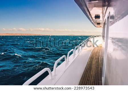 White yacht in the red sea at sunset. Beautiful summer seascape. Creative toning effect - stock photo