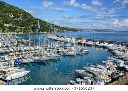 White yachts docked in mediterranean port of Alassio on italian Riviera, Liguria, Italy - stock photo