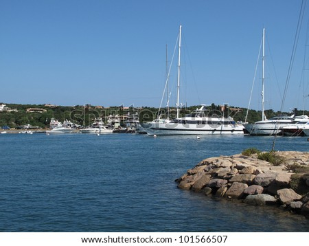 white yachts lined up at the marina - stock photo