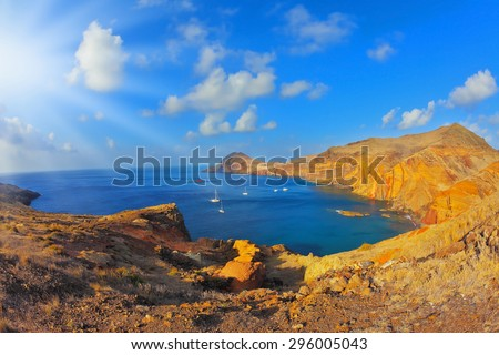White yachts lit sunset. Quiet ocean cove on the island of Madeira. Calm on the Atlantic Ocean - stock photo