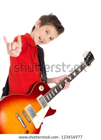 White young boy with a electric guitar shows the heavy metal gesture - isolated on white background - stock photo