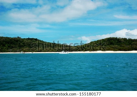 Whitehaven Beach in Whitsundays, Queensland, Australia.  The island is accessible by boat from the mainland tourist ports of Airlie Beach and Shute Harbour, as well as Hamilton Island  - stock photo