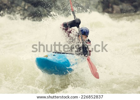 Whitewater kayaking through Boulder Drop on the Skykomish River in Washington State. - stock photo