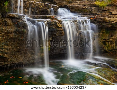 Whitewater pours over rock ledges at Indiana's Upper Cataract Falls. Cataract Falls is located in Lieber State Recreation Area at Cagle's Mill Lake State Park. - stock photo