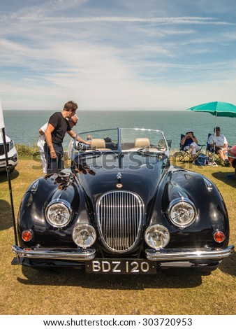 Whitstable, UK, 2nd August 2015. A blue vintage Jaguar car is on display for visitors to Tankerton slopes to enjoy during the classic car motor show in Whitstable, Kent. - stock photo