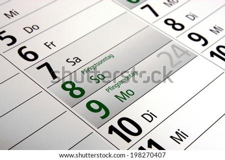 whitsun in a german calendar - stock photo