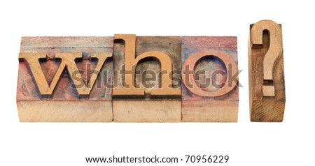 who question in vintage wood letterpress printing blocks, stained by color inks - stock photo