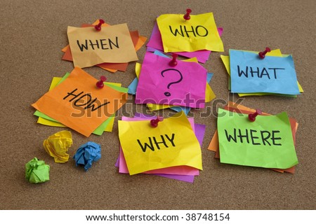 who, what, where, when, why, how questions - uncertainty, brainstorming or decision making concept, colorful crumpled sticky notes on cork bulletin board - stock photo