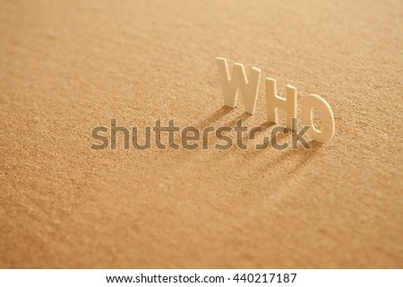 Who word of wood alphabet with shadow on compressed board - stock photo