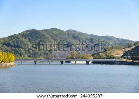 whoe view of Andong Dam across the Nakdong river in Korea - stock photo