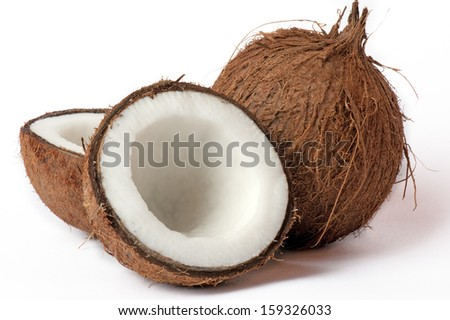 Whole and broken coconut. - stock photo
