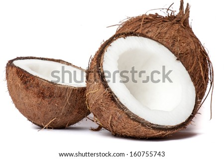 Whole and broken coconut on white background - stock photo