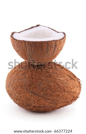 Whole and chopped coconut isolated on a white background - stock photo